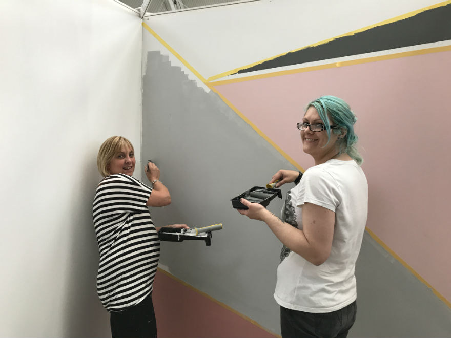 Debbie and Anita creating the trendy walls on Mint's stand.