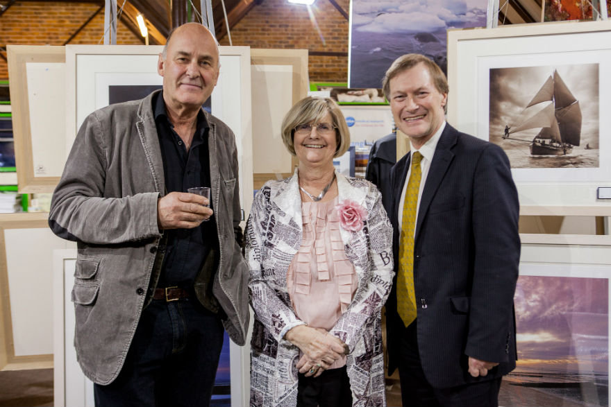 Renowned photographer Charlie Waite with Lynn and her local MP at one of the many art exhibitions she curated and organised.
