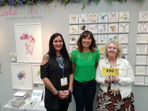 Lesley Dunne (right) and Lisa Dean (left) from Feathering Your Nest with Amanda Mountain on Lola Design's stand