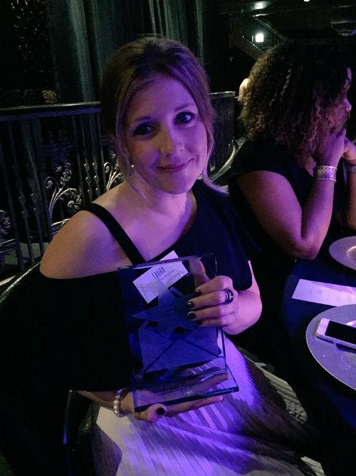 Laura Darrington with her Louie award.