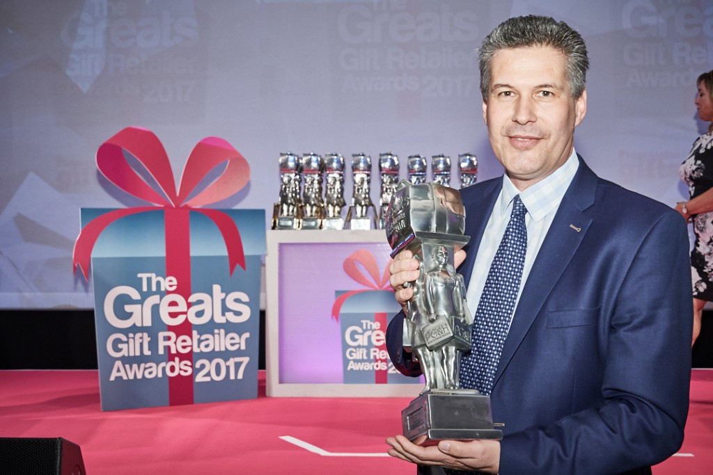 Between the Lines co-owner Florian Kleinlercher with the trophy for Best Multiple Retailer of Gifts.