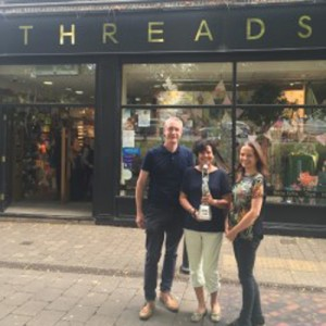 Delighted Threads owners and Retas winners, mum and daughter team Cheryl Clements and Lara Wares with Lara's husband Rodger