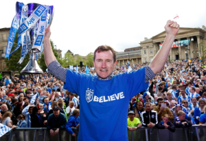 Above: A jubilant Dean Hoyle who feel triumphant about how his team Huddersfield Town is performing in a similar way to the pride he felt when Card Factory exceeded expectations.