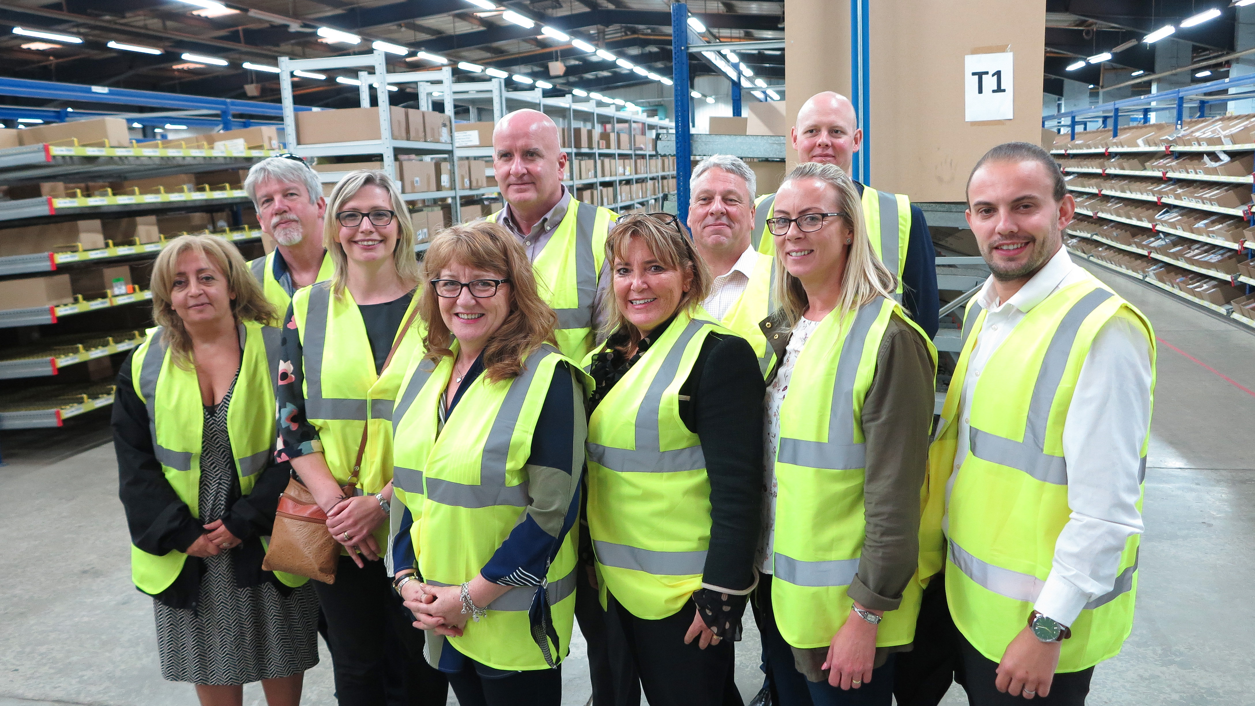 Independent retailers were treated to a 'behind the scenes' tour of its Dewsbury set-up by UKG as part of yesterday's Customer Retail Forum. (Right-left) Sonny Farr (UKG), Darren Cave (UKG), Louise Parker (Daniels), UKG's Ken Roberts, Tracey McMinn, Terry Davis, Jayne Griffiths (Sentiments), Rachael Barnes (Dragonfly), Trevor Griffiths (Sentiments) and Rawda Jehanli (Boswells).