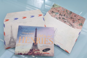 The beautiful Henries ticket, which is a pull-out postcard pack, designed by Paper Rose and produced by Windles.