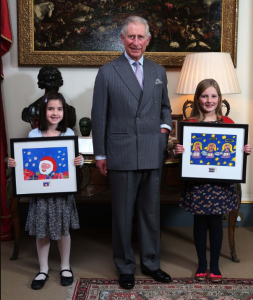 HRH Prince Charles with the winners of the 2013 design a Christmas stamp competition. This year's designs will go on sale at the start of November.