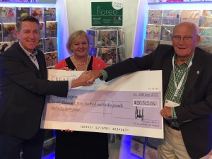 (Left-right) Chris Houfe, sales director  of GBCC handed the cheque to Greenfingers' head of fundraising and communications Linda Petrons, and the charity's chairman, John Ashley.