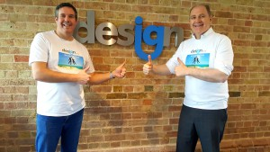 Above: IG Design Group's ceo Paul Fineman (right) and Anthony Lawrinson, chief financial officer, wearing their 'debt free' t-shirts after the group announced its impressive results.