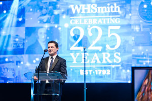 WHSmith's ceo Stephen Clarke on stage at the anniversary charity ball.