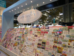 Signage featuring the new tagline, 'Home to the best range of brands in the industry' hung above the displays on the stand.