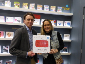 Charlotte Reed on the Danilo stand at the Spring Fair with the publisher's licensing director Dan Grant holding the wall calendar that is being published for 2019.