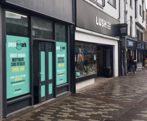 Posters announce the arrival of Postmark's latest shop in Kingston in April.