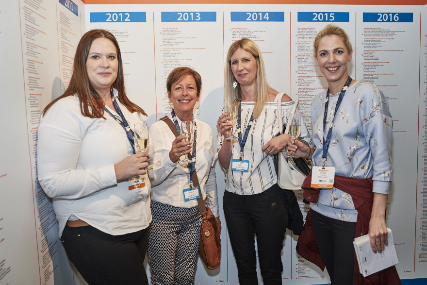Sainsbury's Carly Pearson (far left) and Naomi Boards with Amanda Scrivener (second left) and Claire Cheng (both of UKG) enjoying some bubbles at the Wall of Fame at the show.