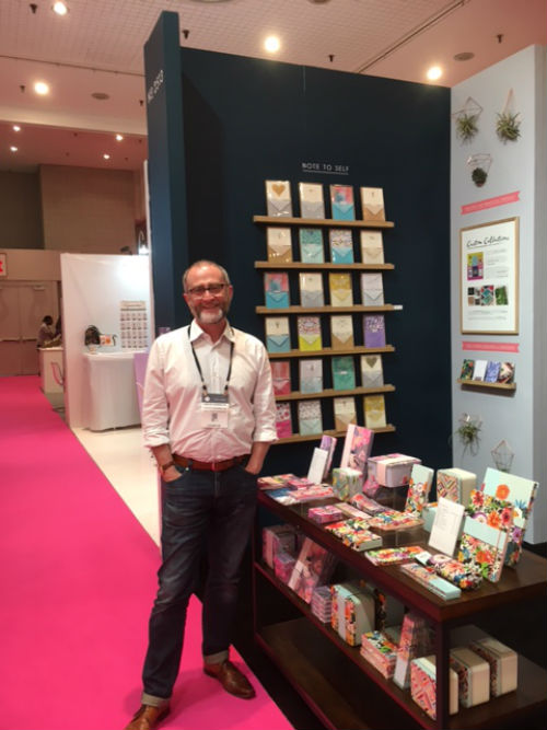 Simon Harrison, founder of Portico Designs on the publisher's stand that was showing its latest stationery ranges.