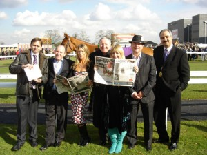 Ian (centre) with the Ling Design team out at the races