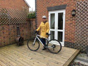 Above: Jacqui Colquhoun with her new bicycle presented in recognition of 10 years of working for House of Cards.