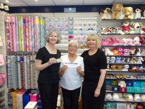 Above: Jean Allridge and Jayne Manning with their gifts with (right) Angela Stargatt, manager of House of Cards' Caversham branch.