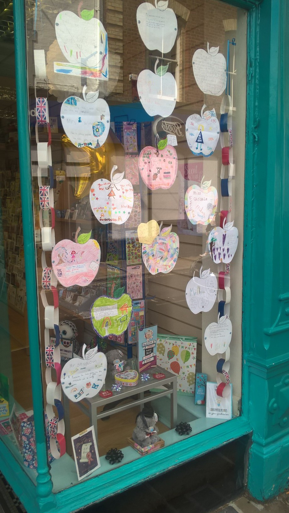 The 'apples for teacher', created by the school children adorned the shop's window in the run up to the end of term.