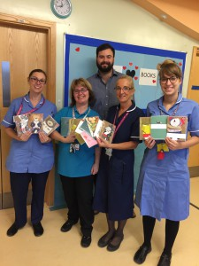 The Art File's James Mace with nurses in Nottingham Children's Hospital with a selection of cards that patients, medical staff and visitors were able to use to send cards as part of the ToYW activity.