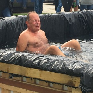 Windles' Bruce Podmore was happy to take one for the team and plunge into cold water to scoop victory on the day.