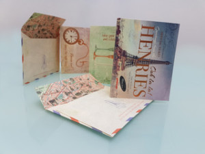 Paper Rose's Jojo Norris came up with the concertina postcard pack design and Windles printed the ticket as well as the bespoke envelope.