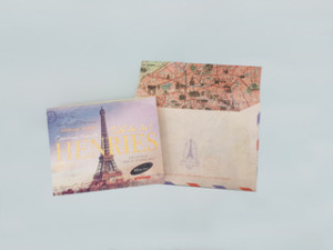 The Henries keepsake ticket sets the scene for the Parisian theme of the event.