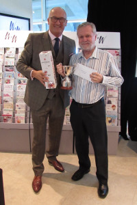 David Larmour (right) was presented with pronounced Sales Person of the Year Award by joint md Rod Brown.