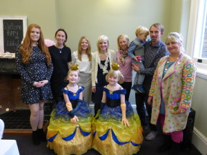 Poppy (right) and her cousin Libby with Poppy's parents Cheryl (centre) and Chris, brother Finn and Libby's mum Emma with PG's Jakki Brown (far right), Hallmark's Ellen Harrison (far left-right) and Emily Patterson and Rubies' Zoe O'Connell.