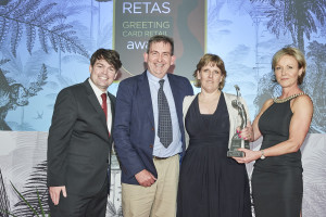 Paul and Zoe Carter collecting their winning Retas trophy from Jackie Collins, md of Cherry Orchard, sponsor of the Best Newcomer North category, with host Charlie Baker.