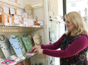 Ros ensuring the jewellery display is looking tickety boo.