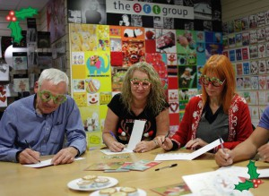 The team at Paper Rose writing cards on Festive Friday last year.