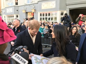 Prince Harry and Meghan Markle accepting the special engagement card that was created by Paper Rose.