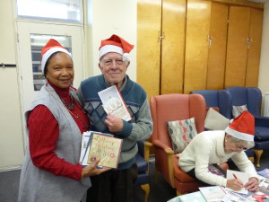 Members of the Age UK Drovers Centre were keen to get stuck in writing Christmas cards that had been donated by publishers via the GCA.