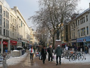 Snow close to Christmas could actually benefit retailers as last-minute online purchases may not be delivered in time.