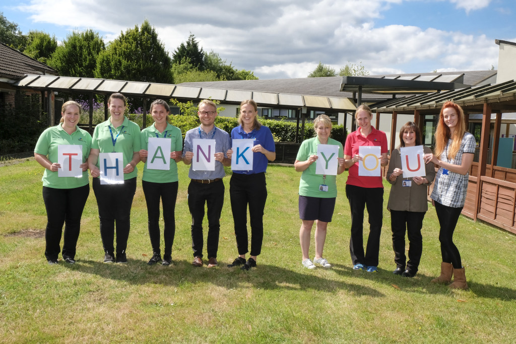 Volunteers and staff from the Children's Trust thank The Light Fund for £5000 to fund a new bath at Jasmine House.