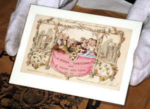 An example of the first Christmas card, designed by Sir John Calcott Horsley, having been commissioned by Sir Henry Cole.