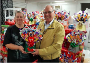 Beverley presenting the winner of a hamper as part of its charity fundraising.