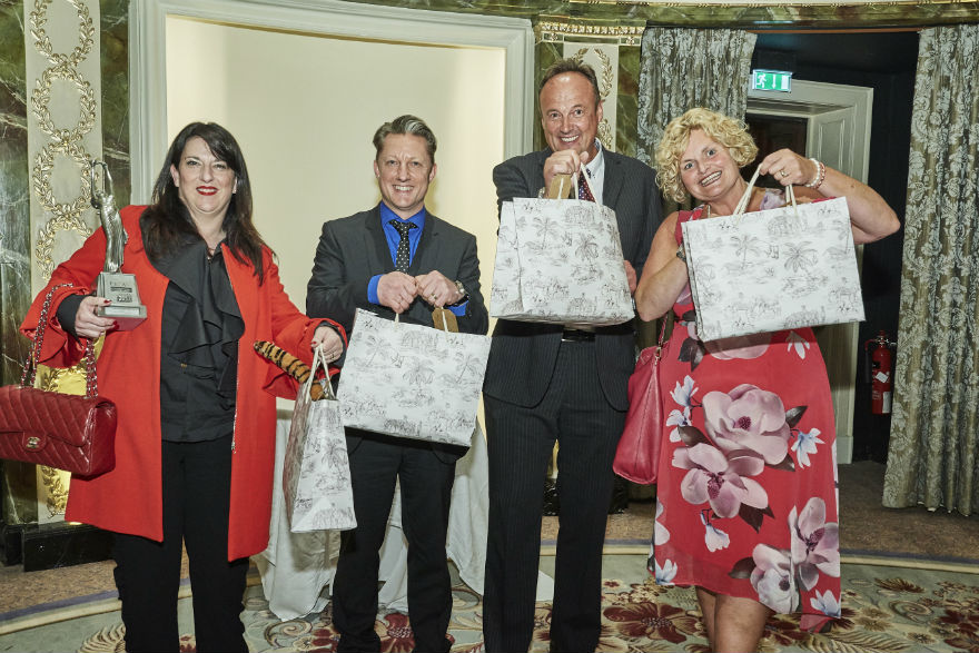 Above: (Right) Amanda and Will Oscroft (Love It) with fellow retailers Steve and Julie McHale (Bentleys) with the wonderful goody bag that everyone received at last year's Retas.