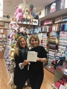 Andrea Pinder (right) in the Manchester Unit 7 store with assistant manager Sylvia Simighova with the Valentine's Day card from Blue Eyed Sun.