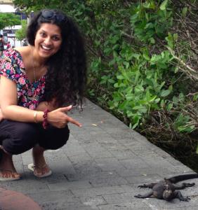 Sai in the Galapagos with a marine iguana.