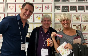 Richard and Ann Gascoyne from Salhouse Garden Centre hold their favourite chocolates that were given to them by Blue Eyed Sun's Jeremy Corner.