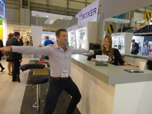 Thomas O'Brien, Boxer's md in yoga pose with Julie Livesley on the company's stand at the Spring Fair.
