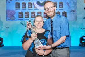 Beverley and John Heyworth at the recent Retas awards with their trophy for Best Greeting Cards Retailer Initiative.