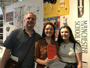 Maisy Summer Lewin-Sanderson (centre) and her sister Bibi Lola with their dad Geoff Sanderson at New Designers.