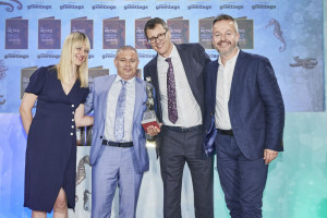 House of Cards' partners Miles Robinson (second left) and Nigel Williamson (second right) receiving their Retas award from Michael McGunnigle, national accounts manager of GBCC, sponsor of the Best Small Retailer of Greeting Cards award and host of the event, Tania Edwards.