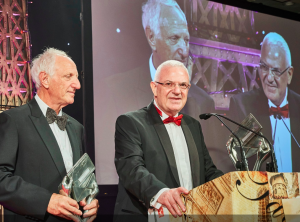 Second Nature directors Rod (right) and Trevor Schragger collecting their Honorary Achievement awards at The Henries 2017.