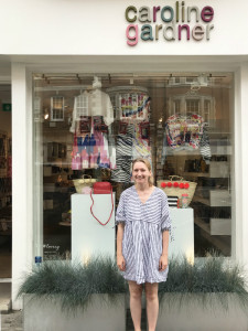 Young designer Lucie Perry outside Caroline Gardner's Marylebone Street store in which her fashion collection is in the window