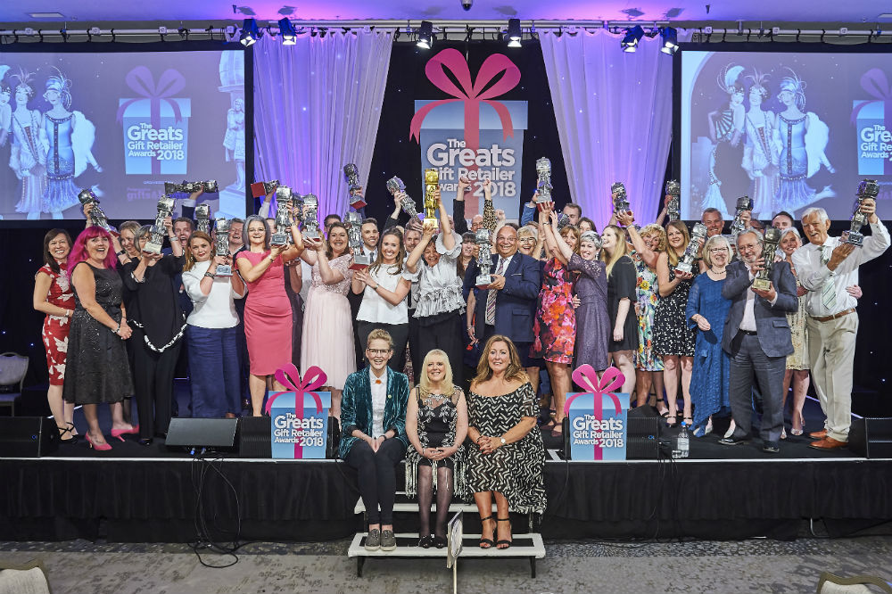 All the winners of The Greats on stage at the Grosvenor House Hotel last Thursday with host, Pippa Evans at the front with PG&H's Sue Marks and Angie Bryant.