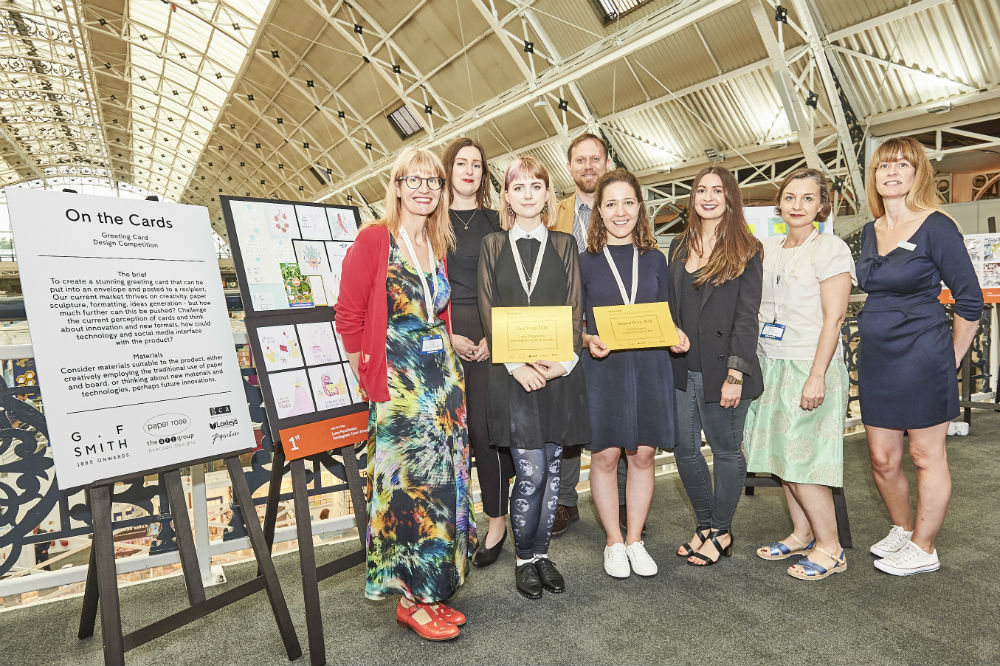 The On The Cards winners and sponsors together at PG Live. (Left-right) Reggie Pugh (Paper Rose), Hazel Walker (Paperchase), Luna Paszliewicz (winner), Mark Jessett (GF Smith), Emily Rogers (second prize winner), Emma Clooney (Paperchase), Philippa Phipps (Paper Rose) and Gale Astley (PG).