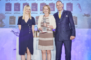 Pigment's Steve Baker on stage at The Retas presenting Cadeaux and Co's Kristen Miller with her award (centre) with host Tania Edwards.